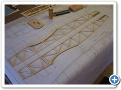 The fuselage side frames are built directly over the plans.