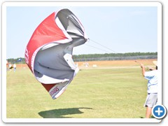"Andrew Yurkovich has fun ""flying"" a tent canopy in the strong winds"
