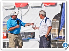 Event Director Matt Klos Hands Darell Sprayberry his award for Best of Show in Helicopters for his OH 58A.