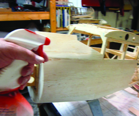 Sheeting the fuselage of the Stinson SR-9