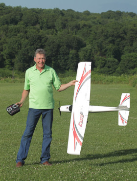 Fly RC Test Pilot, David Baron, holds the Sensei up for a photo op before takeoff.